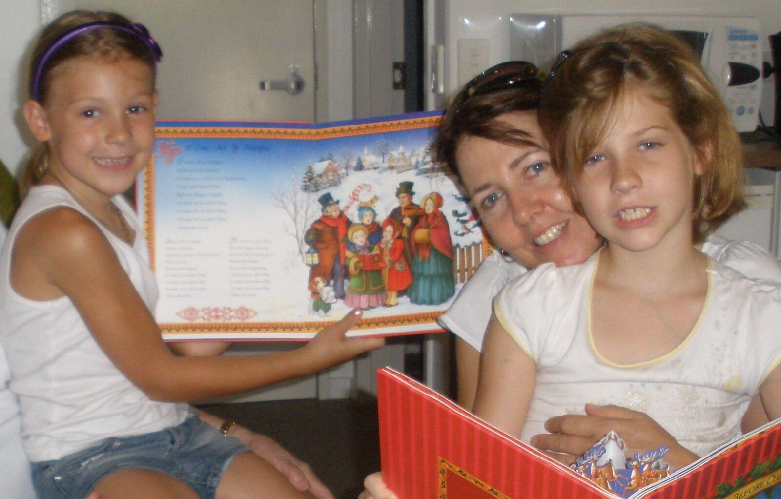 CHILDREN's EBOOKS author Anne Garton reading to her girls.